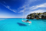 Fototapety Beautiful bay with sailing boats, Menorca island, Spain
