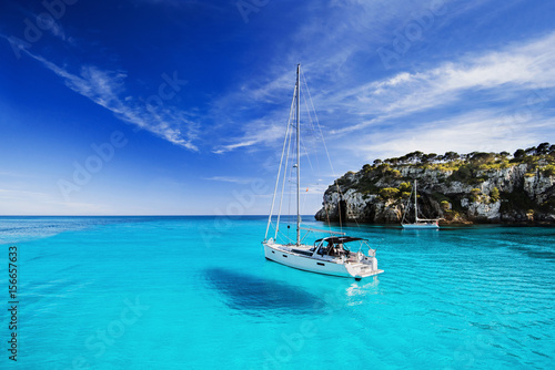 Papiers peints Turquoise Beautiful bay with sailing boats, Menorca island, Spain