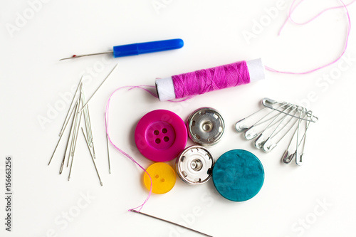 Poster sewing buttons, needles, pins and thread spool