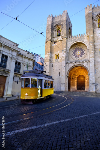 Traditional yellow tram at old streets Canvas Print