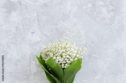 Foto Spatwand Lelietjes van dalen Lily of the valley bouquet on a concrete texture