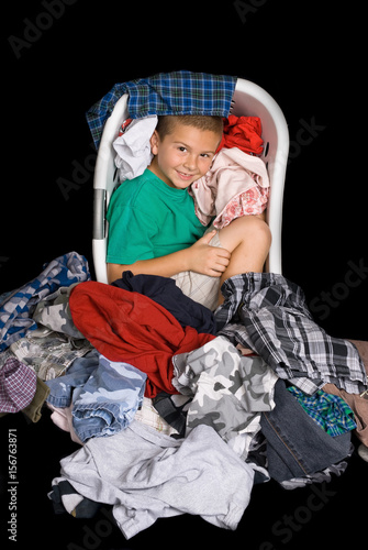 Boy in clothes basket Poster