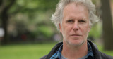 Middle aged man in city park face portrait - 156825226