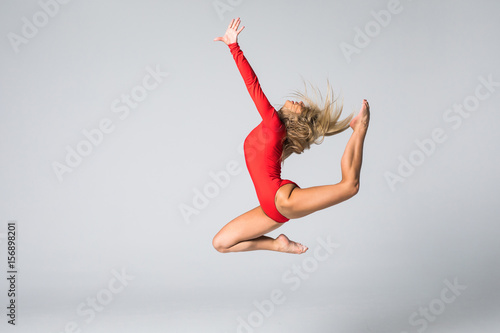 Poster beautiful gymnastic or dancer woman posing on white isolated background