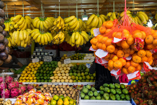 Fotobehang Kuala Lumpur Fruit stall with bananas of different types and other fruits at Chow Kit market, Malaysia.