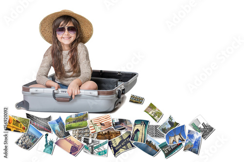 Foto op Plexiglas New York TAXI Long haired little girl with straw hat is sitting in a open suitcase. Photos of the sights of New York City (USA) flies around the suitcase. All is on the white background. Horizontally.