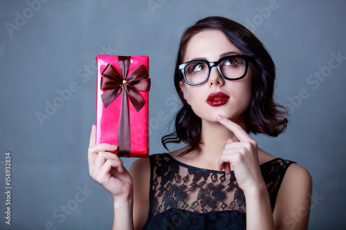 Poster young woman with gift
