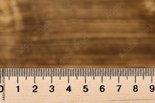 Poster Ruler of wood on vintage wooden background