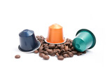 coffee capsules with coffee beans on white background