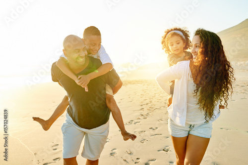 Poster Happy African-American family walking on beach