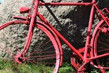 An image of a red bicycle