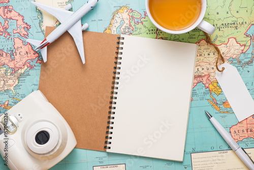 Foto Murales Travel. Trip. Vacation - Top view of airplane, camera, passport and touristic map