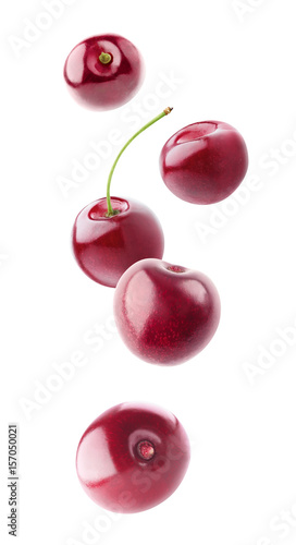Plexiglas Kersen Falling sweet cherry fruits isolated on white background with clipping path