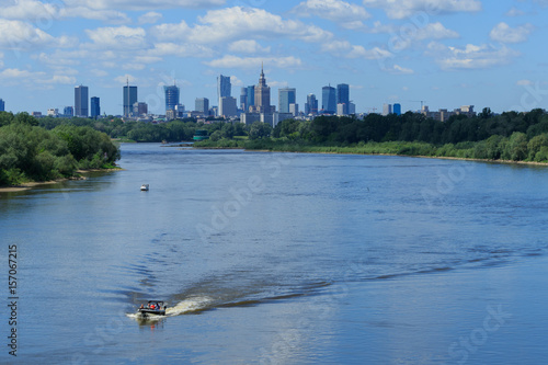 Warsaw skyline with skyscrapers and motorlboats on the Vistula river