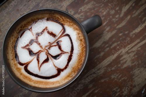 Papiers peints Cafe hot coffee with foam milk art in afternoon break