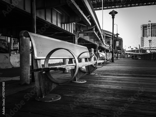 park bench on wooden floor in black and white