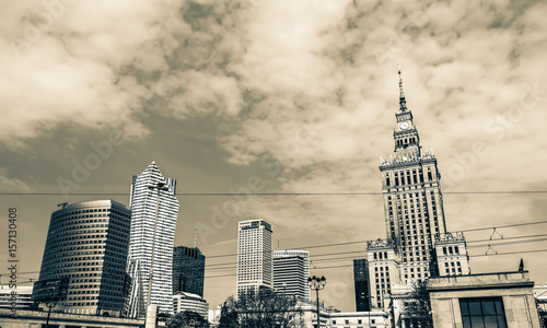 Panorama of Warsaw with modern skyscrapers on a sunny day overlooking the Palace of Culture. Old retro vintage style photo. - 157130408