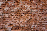 Ancient ruined brick wall, background or texture