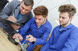 Male apprentices being assessed
