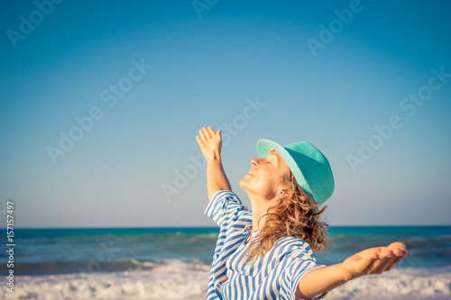 Happy woman on summer vacation Poster