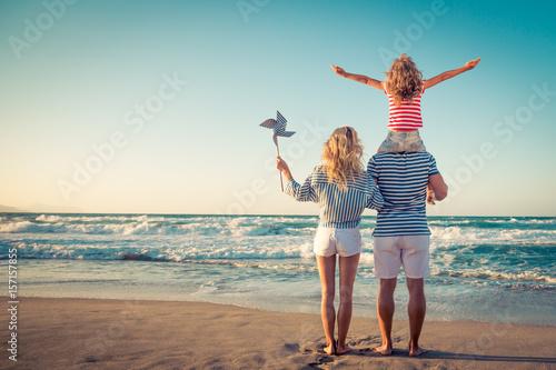 Leinwandbild Motiv Happy family having fun on summer vacation