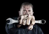 Mechanic holding wrench - 157193834