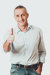 Portrait of mature man gesturing ok sign