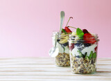 Breakfast homemade granola with berries and chia seeds in a glass jar