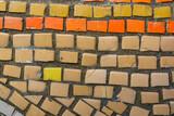 Bright orange tile in stone wall