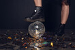 Quadro Close-up partial view of young woman in stylish shoes standing on shiny disco ball