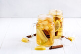 Infused water Fresh homemade ice tea with apple citrus and cinnamon