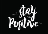Stay positive. Greeting card with modern calligraphy and hand drawn elements. Isolated typographical concept. Inspirational motivational quote. Vector design.