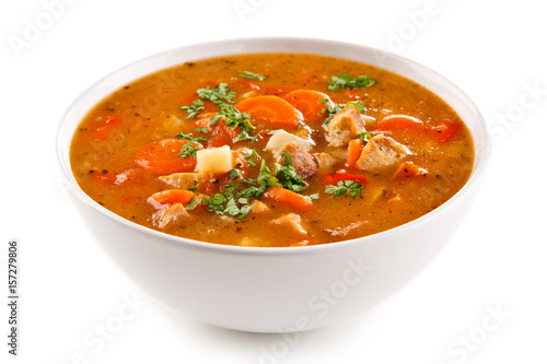 Tomato soup with carrot and chicken on white background - 157279806