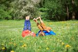 little boy and girl relax on green grass - 157280648