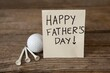 Fathers day greeting card with golf ball on table