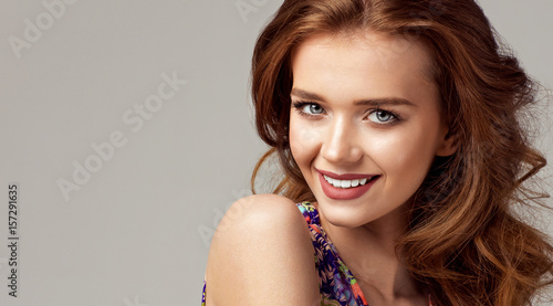 Beautiful woman with natural smiling face. Natural photo without retouch