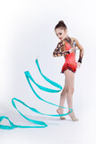 beautiful caucasian girl gymnast with Turquoise ribbon