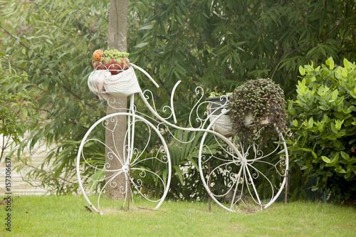 Old bicycle used to decorate the garden.