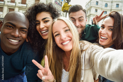 Multiracial group of young people taking selfie Poster