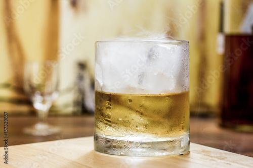 Whiskey tumbler glass smoky ice Poster
