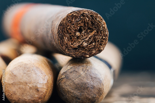 Close-up of Cuban cigars on brown marble. Macro shot.
