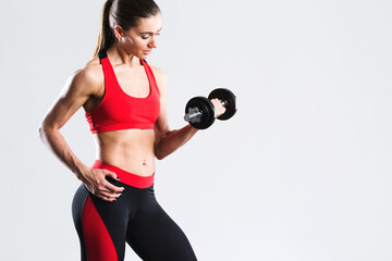 Woman workout with dumbbells, isolated. © BestForYou