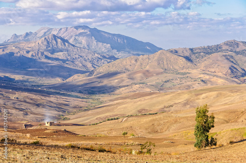Ploughed fields and the Sicani Mountains between Agrigento and Palermo - Sicily, Italy