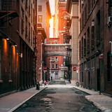 Fototapeta Nowy Jork - New York City street at sunset time. Old scenic street in TriBeCa district in Manhattan. © janifest