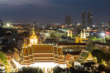 A night view of wat Thepthidaram from the Golden Mount in Bangkok old town. This city is Thailand capital city and dotted with Buddhist temples.