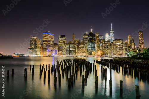 The illuminated Skyline of New York City from the Brooklyn Bridge Park Poster
