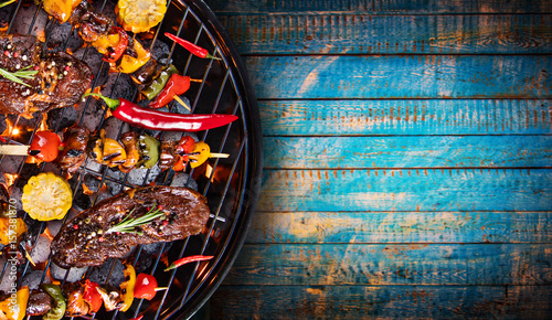 Barbecue grill with beef steaks, close-up. - 157381870