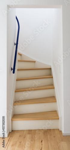 Foto op Plexiglas Trappen A wooden ladder leading up through white walls