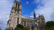 Photo of famous Notre Dame cathedral on a cloudy spring morning, Paris, France