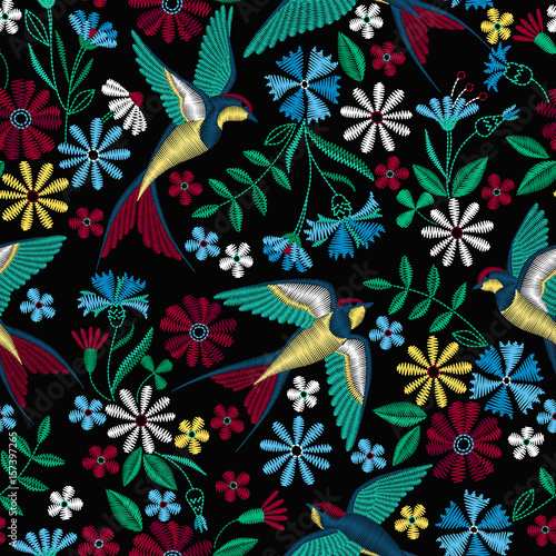 Materiał do szycia Embroidery seamless pattern with swallow birds and beautiful flowers. Vector embroidery for fashion textile and fabric.
